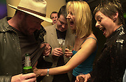 Liam Cunningham, Ian Devane ( Lisa Stansfield's husband ) , Sonia Irvine and Lisa Stansfield. Jaguar party. Casa Batllo, Barcelona. 27 April 2001. © Copyright Photograph by Dafydd Jones 66 Stockwell Park Rd. London SW9 0DA Tel 020 7733 0108 www.dafjones.com