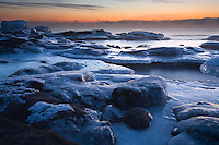 Dawn scene of an icy late January shoreline of Lake Superior in Minnesota, USA.