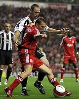 Photo: Paul Thomas.<br /> Liverpool v Newcastle United. The Barclays Premiership. 20/09/2006.<br /> <br /> Craig Bellamy (red) of Liverpool fends off Craig Moore.