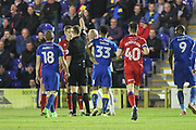 Jim McNulty yellow card during the EFL Sky Bet League 1 match between AFC Wimbledon and Rochdale at the Cherry Red Records Stadium, Kingston, England on 28 March 2017. Photo by Daniel Youngs.
