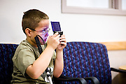 Corey Haas, 8, plays a video game before entering surgery at the UPenn Medical Center in Philadelphia, PA on Thursday, September 25, 2008. Corey is sight-impaired and will undergo surgery injecting genetic material into his left eye in hopes of improving his vision.