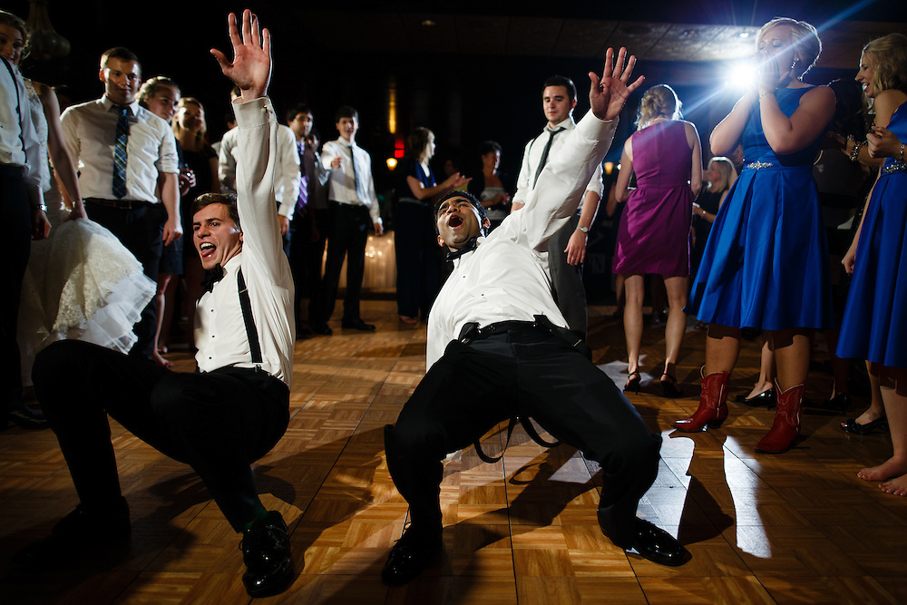 Groomsman dance during Nicole and Elliott's wedding at Trappers Turn Golf Course in Wisconsin Dells, Saturday, Aug. 29, 2015. Photo by Justin Edmonds