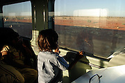 An aboriginal kid travels on the Ghan with his family, north of Coober Pedy