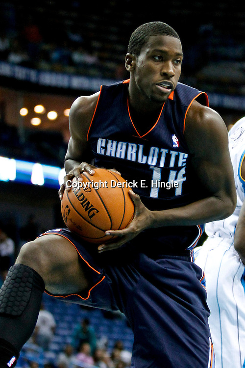 October 9, 2012; New Orleans, LA, USA; Charlotte Bobcats forward Michael Kidd-Gilchrist (14) comes down with a rebound against the Charlotte Bobcats during the second quarter of a game at the New Orleans Arena.   Mandatory Credit: Derick E. Hingle-US PRESSWIRE
