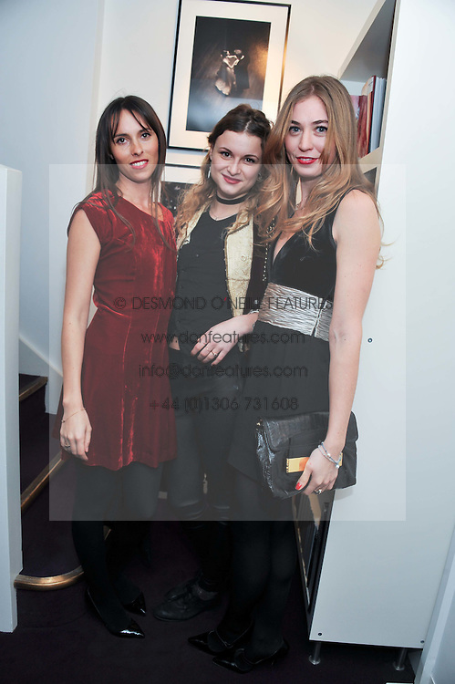 Left to right, LULU BARSOTTI, BENEDICTE WILHELMSEN and ANOUSKA BECKWITH at a private view of photographs by Anthony Souza held at The Little Black Gallery, 13A Park Walk, London SW10 on 13th December 2011.