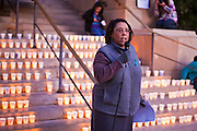 22 DECEMBER 2011 - PHOENIX, AZ:   A woman who identified herself as a survivor of rape and sexual assault reads a poem she wrote during a protest against sexual violence in Phoenix. About 300 people marched through downtown Phoenix Thursday night in a silent candle lit procession to protest against the way the Maricopa County Sheriff's Department, led by Sheriff Joe Arpaio, has conducted sexual assault and rape investigations. Two recent media reports, one by the East Valley Tribune, a newspaper in Mesa, AZ, and one by the Associated Press, concluded that the Sheriff's department has bungled more than 430 rape investigations. Last week, a US Department of Justice report cited the unresolved rape investigations along with evidence of wide spread racial profiling by the sheriff's department in a report that was highly critical of Sheriff Arpaio and the Sheriff's Department.     PHOTO BY JACK KURTZ