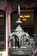 Bronze elephant-heads statue in the courtyard of the Jade Buddha Temple, Shanghai, China