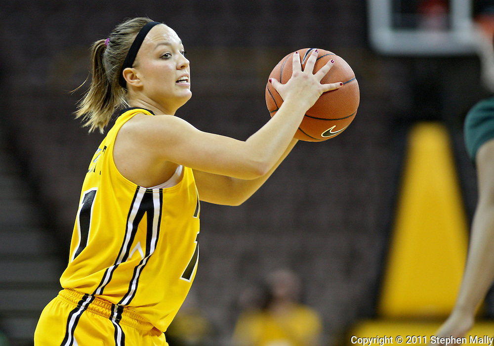 January 27 2010: Iowa guard Trisha Nesbitt (11) looks to pass during the first half of an NCAA women's college basketball game at Carver-Hawkeye Arena in Iowa City, Iowa on January 27, 2010. Iowa defeated Michigan State 66-64.