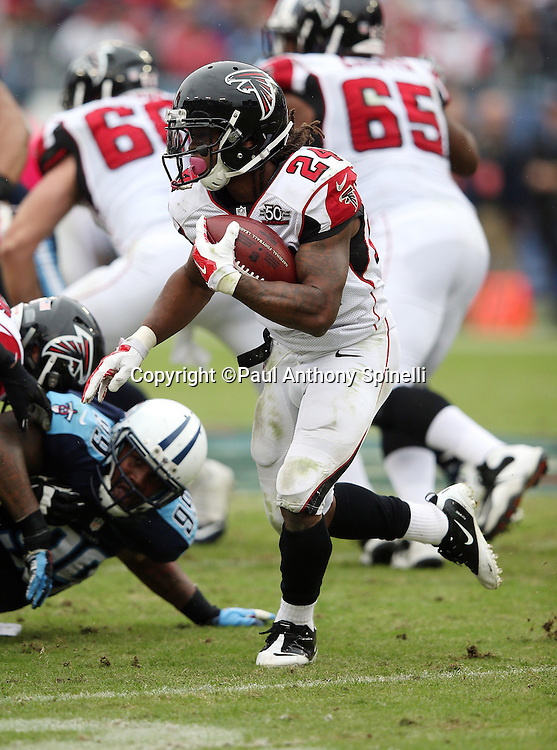 Atlanta Falcons running back Devonta Freeman (24) runs the ball during the 2015 week 7 regular season NFL football game against the Tennessee Titans on Sunday, Oct. 25, 2015 in Nashville, Tenn. The Falcons won the game 10-7. (©Paul Anthony Spinelli)