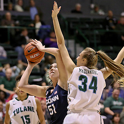 Feb 3, 2016; New Orleans, LA, USA; Connecticut Huskies center Natalie Butler (51) shoots over Tulane Green Wave center Ksenija Madzarevic (34) during the second quarter of a game at the Devlin Fieldhouse. Mandatory Credit: Derick E. Hingle-USA TODAY Sports