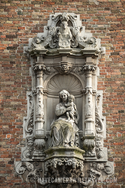 A statue of the Madonna and child on the outside of the Belfry in the Markt (Market Square) in the historic center of Bruges, a UNESCO World Heritage site.