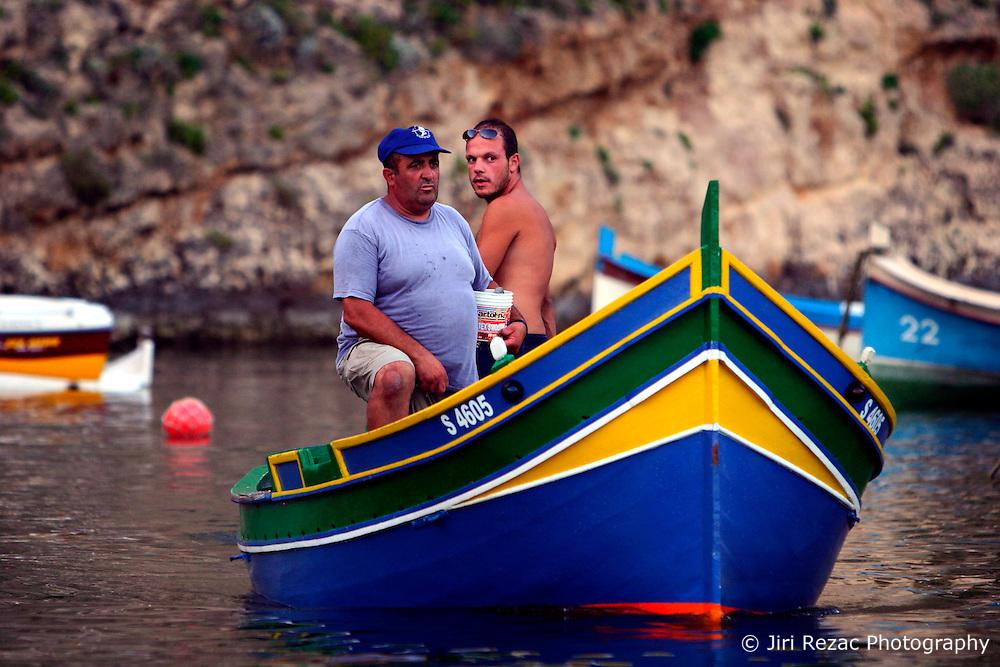 MALTA GOZO DWEJRA 22JUL06 - Fishermen arrive back at the Inland Sea, a landlocked body of seawater connected to the Mediterranean via a tunnel in the towering cliff face. ..jre/Photo by Jiri Rezac..© Jiri Rezac 2006..Contact: +44 (0) 7050 110 417.Mobile: +44 (0) 7801 337 683.Office: +44 (0) 20 8968 9635..Email: jiri@jirirezac.com.Web: www.jirirezac.com