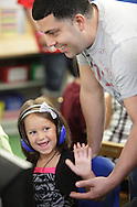 "Chorley Elementary School kindergarten student Samantha Pupo high fives her father Leo Pupo after she put the right letter in the right place on the computer during ""Bring Your Kids to Kindergarten Day"" in Middletown on Thursday, Sept. 6, 2012."