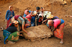 Children and adults together work on the road from Rolpa to Thabang in western Nepal, Nepal March 14, 2005. Nearly every citizen living in the Maoist controlled area must work for 15 days straight, manually digging through the mountaineous region to construct the road that the Maoists promise to bring in defiance to the central government who they say had been promising for decades. (Ami Vitale)