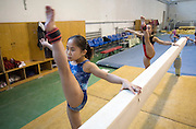 Young girls warm up before an afternoon traininf session of the Beijing gymnastic team in Beijing.