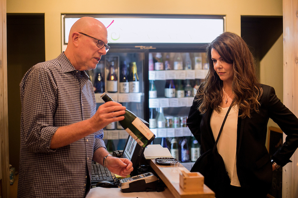 NEW YORK, NY - OCTOBER 3, 2016: Actress Lauren Graham buys sake at Sakaya from owner Rick Smith in New York, New York. CREDIT: Sam Hodgson for The New York Times.