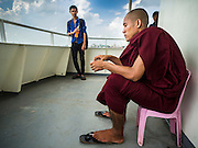 30 OCTOBER 2015 - YANGON, MYANMAR:  A Buddhist monk on the Dala ferry. The ferry to Dala runs continuously through the day between Yangon and Dala. Yangon, Myanmar (Rangoon, Burma). Yangon, with a population of over five million, continues to be the country's largest city and the most important commercial center.          PHOTO BY JACK KURTZ