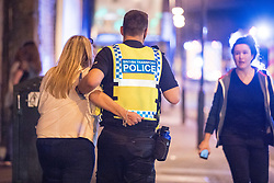 © Licensed to London News Pictures. 22/05/2017. Manchester, UK. Walking wounded on Hunts Bank outside Victoria Station and the stairs leading to the Manchester Arena . Police and other emergency services are seen near the Manchester Arena after reports of an explosion. Police have confirmed they are responding to an incident during an Ariana Grande concert at the venue. Photo credit: Joel Goodman/LNP