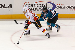 Feb 8, 2012; San Jose, CA, USA; Calgary Flames right wing Jarome Iginla (12) skates with the puck past San Jose Sharks defenseman Marc-Edouard Vlasic (44) during the third period at HP Pavilion. Calgary defeated San Jose 4-3. Mandatory Credit: Jason O. Watson-US PRESSWIRE