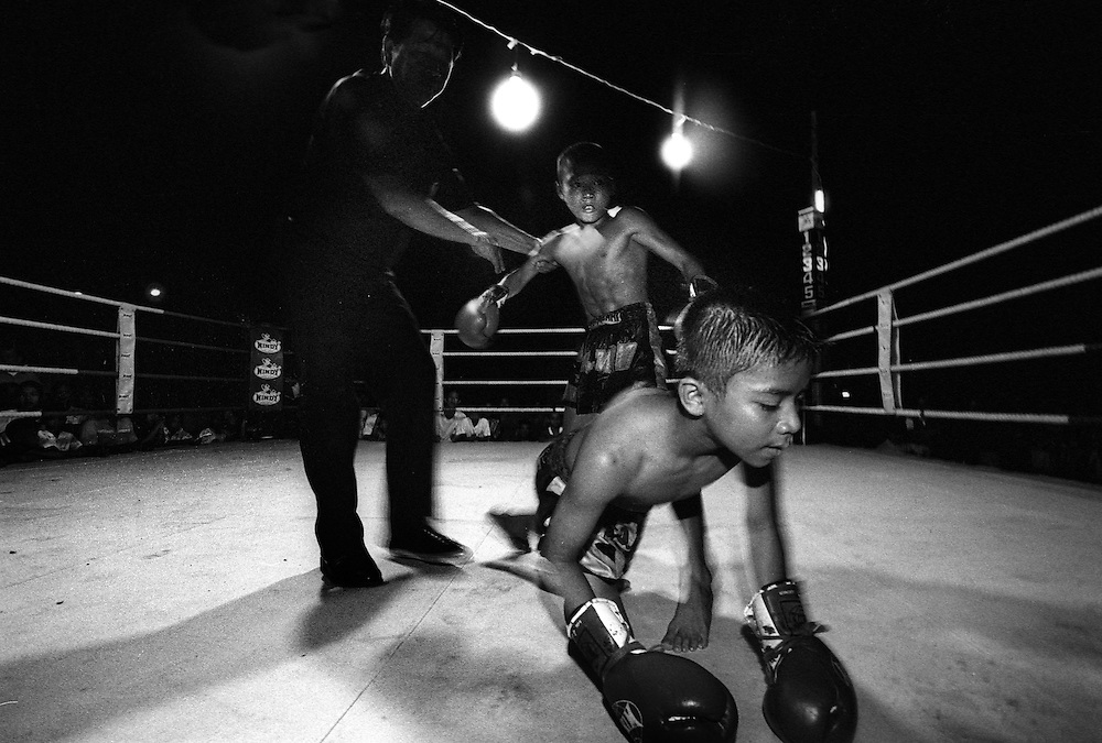 Young Muay Thai kickboxers give it their all at a small make-shift arena just outside Bangkok, Thailand..March 2003.©David Dare Parker /AsiaWorks Photography