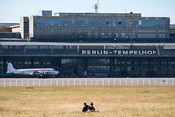 Couple having picnic at former Tempelhof Airport now public park  in Kreuzberg, Berlin, Germany