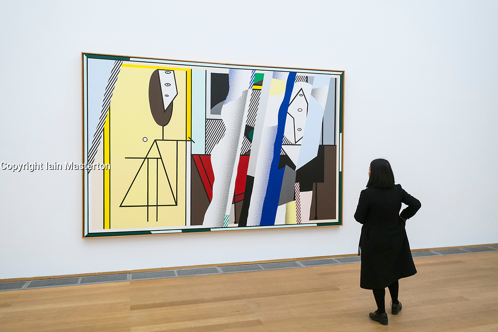 "Woman looking at painting Reflections On ""The Artist's Studio"" by Roy Lichtenstein at Hamburger Bahnhof modern art museum in Berlin, Germany"