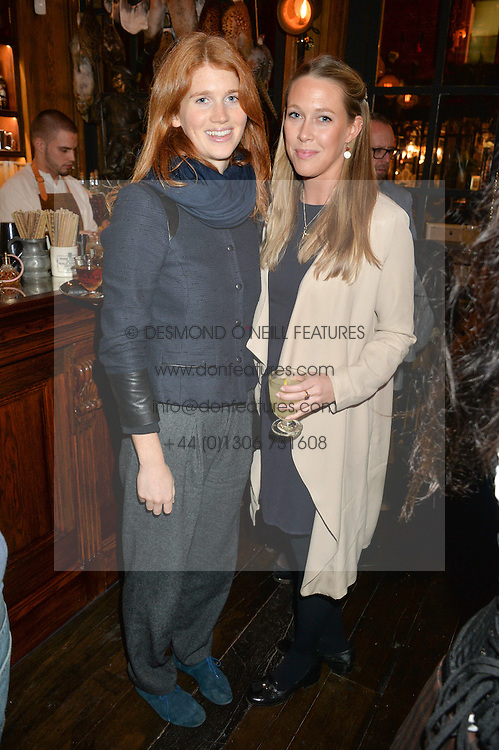 Left to right, LARA HUGHES-YOUNG and EMILY LOPES at the opening party of Mr Fogg's Tavern, 58 St.Martin's Lane, London hosted by William Sitwell on 8th October 2015.