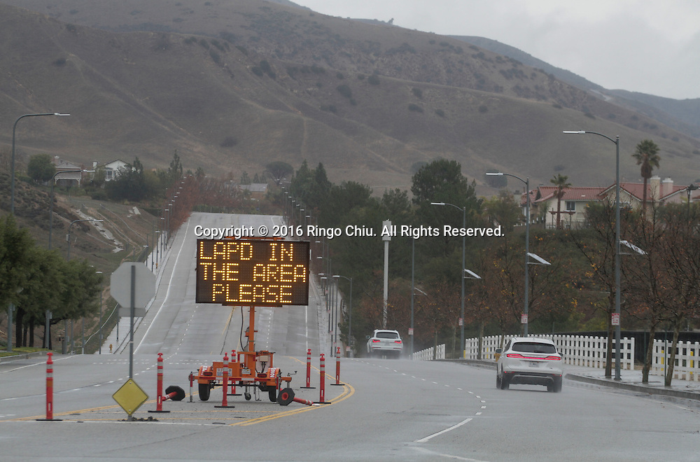 A sign warning sign that reads 'LAPD IN THE AREA PLEASE'  is posted near the Aliso Canyon storage facility at the Porter Ranch area of Los Angeles, California, the United States on January 6, 2015.  California Gov. Jerry Brown declared a state of emergency today in the Porter Ranch area due to the continuing leak of natural gas from the Aliso Canyon storage facility. The leak at Porter Ranch started in October, and likely won&rsquo;t be fixed for at least two more months. Officials have relocated several thousand residents who said the stench made them sick. (Xinhua/Zhao Hanrong)(Photo by Ringo Chiu/PHOTOFORMULA.com)<br /> <br /> Usage Notes: This content is intended for editorial use only. For other uses, additional clearances may be required.