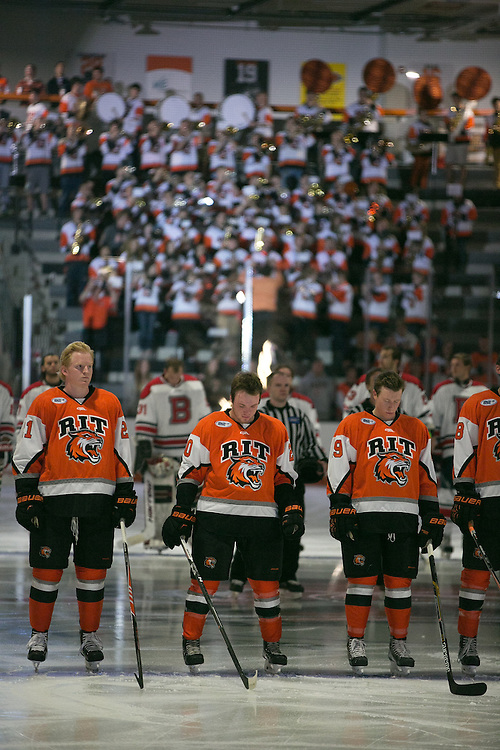 The RIT Men's Hockey team stands for the Canadian and American National Anthems before a game against Brock University at the Gene Polisseni Center on Saturday, October 4, 2014.
