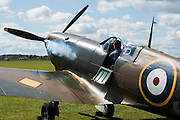 Martin Overall, one of the engineers who refurbished it, starts the engine - Vickers Supermarine Spitfire Mk.1A – P9374/G-MK1A – it was in action in the Battle of France in 1940 and recovered from the sands of a Calais beach in 1980. It was restored by the Aircraft Restoration Company, and will fly in the VE Day Anniversary Air Show (Saturday 23 and Sunday 24 May) at IWM Duxford. Christie's is to offer the Spitfire P9374 for auction in The Exceptional Sale on 9 July 2015.  The estimate for the sale is  £1,500,000-2,500,000. With the plane are John Romain, Pilot and Chief Engineer at the Aircraft Restoration Company and Ken Wilkinson, a veteran who flew Spitfires in the Second World War. IWM Duxford, Cambridge
