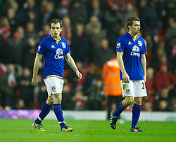 LIVERPOOL, ENGLAND - Tuesday, March 13, 2012: Everton's Leighton Baines and Seamus Coleman walk off dejected as their side trail Liverpool 1-0 at half-time during the Premiership match at Anfield. (Pic by David Rawcliffe/Propaganda)