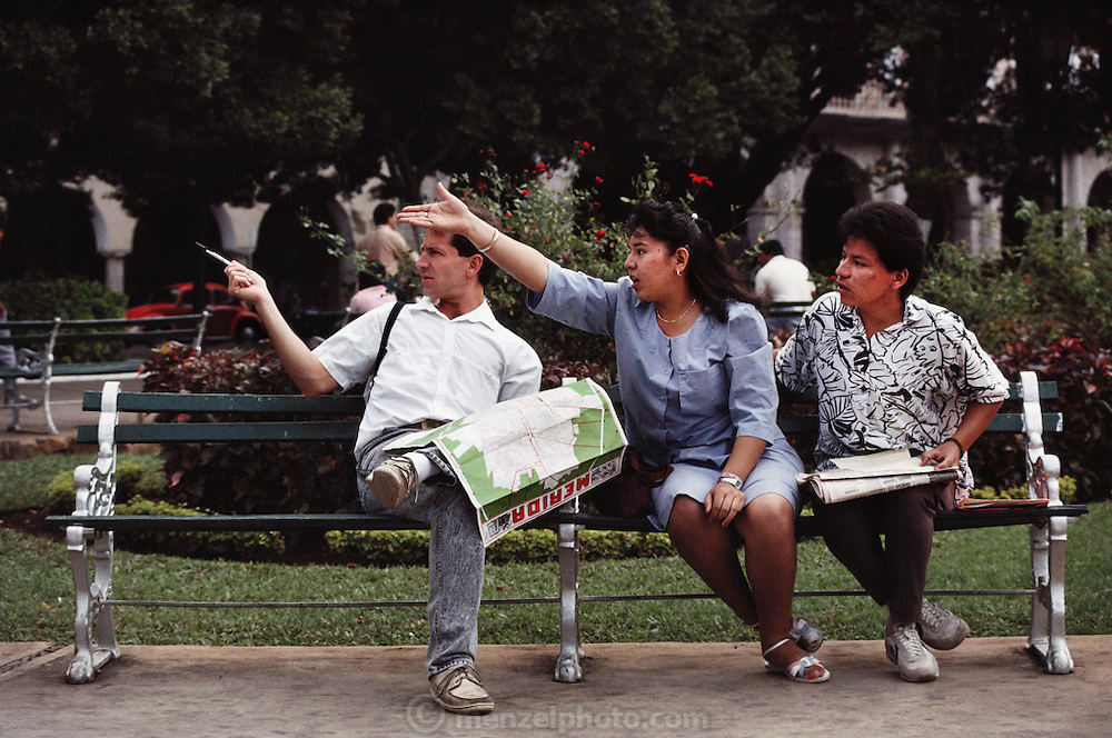 Getting directions from local people on a park bench in Merida, Mexico, Yucatan.