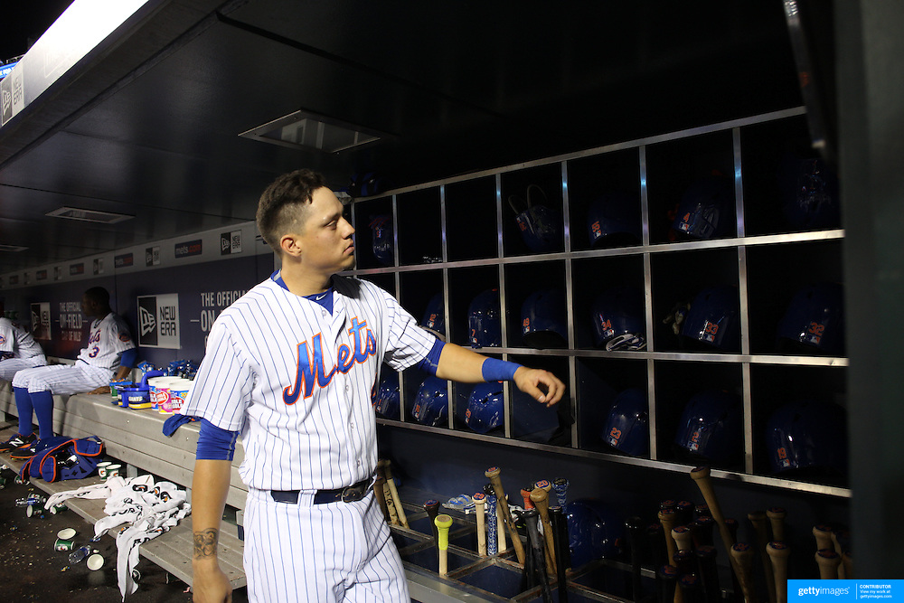 Wilmer Flores, New York Mets, preparing to bat in the dugout during the New York Mets Vs Atlanta Braves MLB regular season baseball game at Citi Field, Queens, New York. USA. 22nd September 2015. Photo Tim Clayton