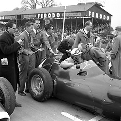 HARRY SCHELL in a BRM at motor racing at Goodwood Race track, Sussex in 1958.