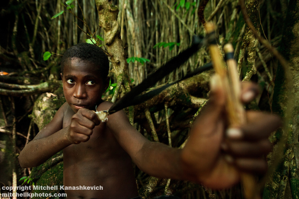 Ni Vanuatu boy hunting flying foxes and birds with a sligshot. Rah Lava Island, Torba Province, Vanuatu