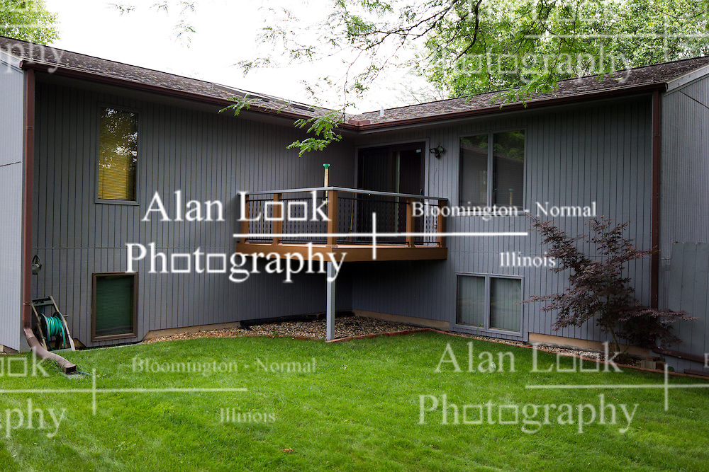 30 June 2014:   Suburban bilevel home with brick and wood siding facade and 3 car attached garage on landscaped lot.