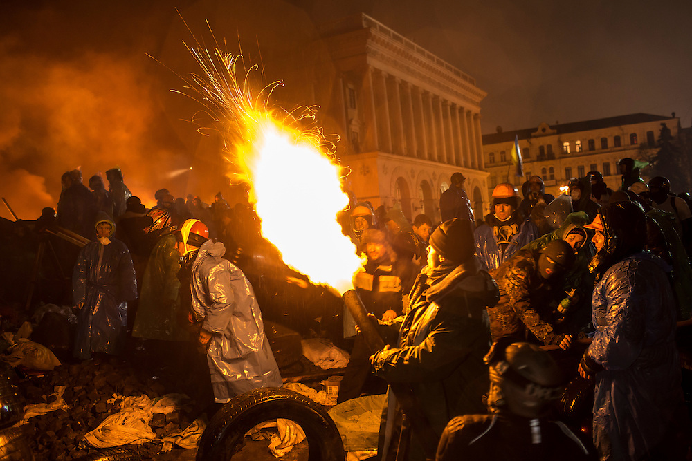 KIEV, UKRAINE - FEBRUARY 19: Anti-government protesters use a compressed air cannon to launch a Molotov cocktail toward police lines on Independence Square on February 19, 2014 in Kiev, Ukraine. After several weeks of calm, violence has again flared between anti-government protesters and police as the Ukrainian parliament is meant to take up the question of whether to revert to the country's 2004 constitution. (Photo by Brendan Hoffman/Getty Images) *** Local Caption ***