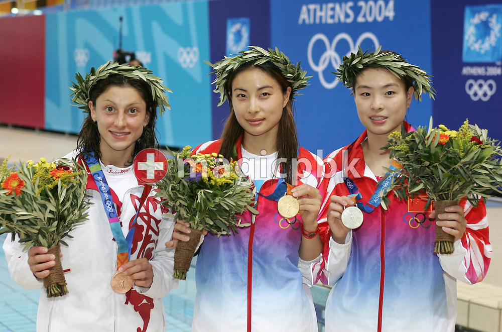 (from left) China's Minxia Wu, China's Guo Jingjing and Russian Yulia Pakhalina and stand on the podium of the women's 3m Springboard finals of the Athens 2004 Olympic Games at the Aquatic Center, Thursday 26 August 2004. Guo Jingjing won the gold and Minxia Wu the silver medal, Yulia Pakhalina bronze.    (Photo by Patrick B. Kraemer / MAGICPBK)