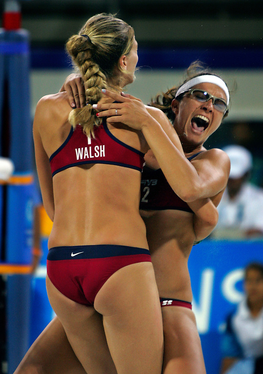 Misty May, right, celebrated match point with her teammate Kerri Walsh, left, at the conclusion of their gold medal victory at the Beach Volleyball Centre during the 2004 Summer Olympic Games in Athens, Greece. May and Walsh won the gold medal in beach volleyball 2 sets to 0 over Brazil.