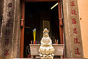 A statue of the bodhisattva Guanyin at a street shrine in Macau.