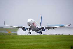 © Licensed to London News Pictures. 15/07/2020. Leeds UK. A Jet2 aircraft heading to Zakinthos takes off in the rain from Leeds Bradford Airport this morning as the airline resumes flights to holiday destinations today. Photo credit: Andrew McCaren/LNP