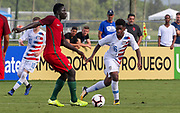 Team USA defender Justin Reynolds (16) looks to steam the ball from Portugal forward Herculano Nabian (9) during a CONCACAF boys under-15 championship soccer game, Saturday, August 10, 2019, in Bradenton, Fla. Portugal defeated Team USA 3-0 and advanced to the finals against Slovenia. (Kim Hukari/Image of Sport)