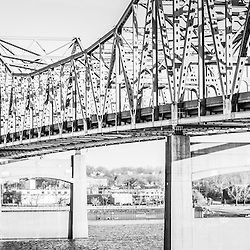 Peoria Illinois panoramic black and white photo of Murray Baker Bridge. The Murray Baker Bridge spans the Illinois River connecting Peoria with East Peoria as Interstate I-74. Built in 1958, the bridge is named after Murray Baker who started a company that would later become Caterpillar. Photo panoramic ratio is 1:3.