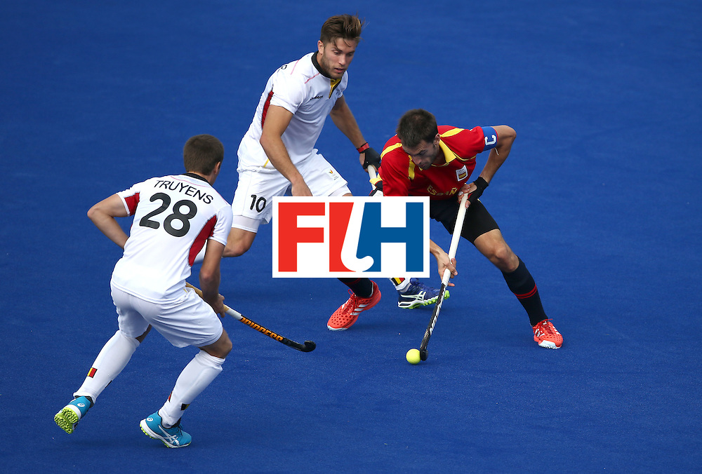 RIO DE JANEIRO, BRAZIL - AUGUST 11:  Cedric Charlier #10 and Jerome Truyens #28 of Belgium defend against Manel Terraza #22 of Spain  during a Men's Preliminary Pool A match on Day 6 of the Rio 2016 Olympics at the Olympic Hockey Centre on August 11, 2016 in Rio de Janeiro, Brazil.  (Photo by Sean M. Haffey/Getty Images)