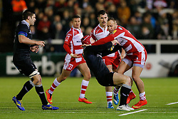 Gloucester Outside Centre Billy Meakes is tackled by Newcastle Flanker Andy Saull - Photo mandatory by-line: Rogan Thomson/JMP - 07966 386802 - 21/11/2014 - SPORT - RUGBY UNION - Newcastle upon Tyne, England - Kingston Park - Newcastle Falcons v Gloucester Rugby - Aviva Premiership.