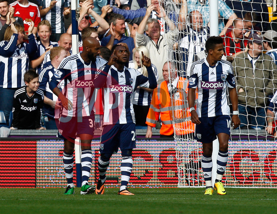 West Bromwich Albion's Stephane Sessegnon celebrates his goal against his former club - Photo mandatory by-line: Matt Bunn/JMP - Tel: Mobile: 07966 386802 21/09/2013 - SPORT - FOOTBALL - The Hawthorns - West Bromwich - West Bromwich Albion V Sunderland - Barclays Premier League