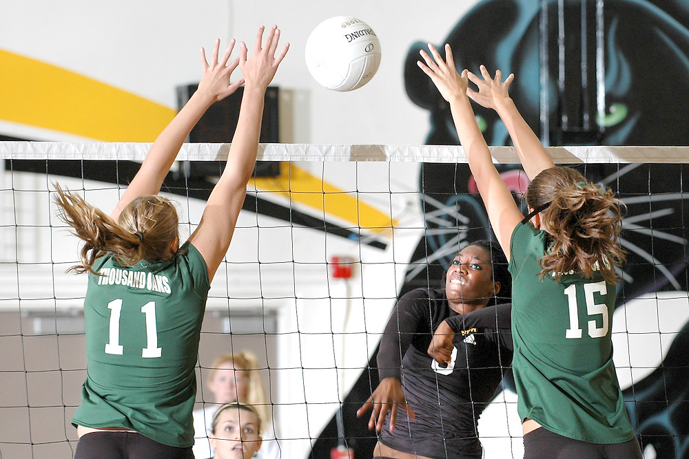 H:\EDITORIAL\Photos\10 October 2009\JH 10-15-09 NPHS # 8 Andreya Van Buren hits the ball past TOHS # 11 Halley Weinstock and # 15 Jillian Johnson during Game 3.
