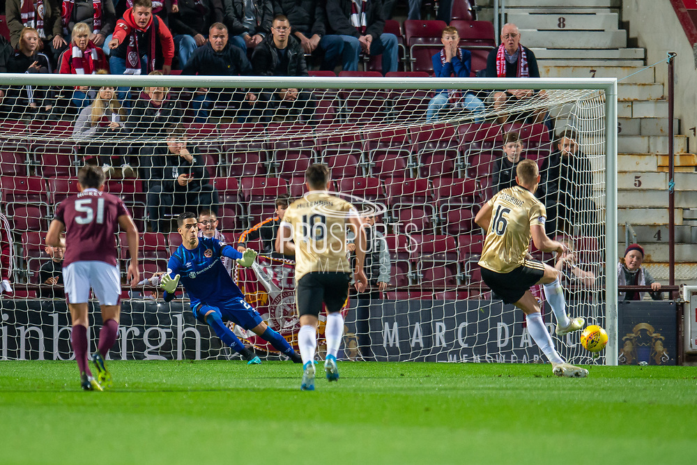 Sam Cosgrove (#16) of Aberdeen FC scores a goal from a penalty during the Betfred Scottish Football League Cup quarter final match between Heart of Midlothian FC and Aberdeen FC at Tynecastle Stadium, Edinburgh, Scotland on 25 September 2019.