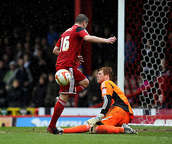 Bolton Wanderers' Adam Bogdan saves at the feet of Bristol City's Steven Davies - Photo mandatory by-line: Joe Meredith/JMP - Tel: Mobile: 07966 386802 13/04/2013 - SPORT - FOOTBALL - Ashton Gate - Bristol - Bristol City V Bolton Wanderers - Npower Championship