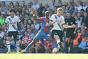 Yannick Bolasie and Eric Dier battle during the Barclays Premier League match between Tottenham Hotspur and Crystal Palace at White Hart Lane, London, England on 20 September 2015. Photo by Alan Franklin.